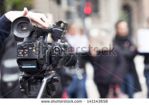 stock-photo-covering-an-event-with-a-video-camera-141143656