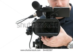 stock-photo-video-camera-operator-working-with-his-professional-equipment-isolated-on-white-background-94460587